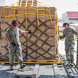 US personnel move cargo scheduled to be delivered to hurricane survivors. (Photo credit: Canadian Department of National Defense)