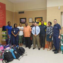 DHS and USCG Donate 224 Backpacks and School Supplies to Students Living in DC Housing Authority Communities