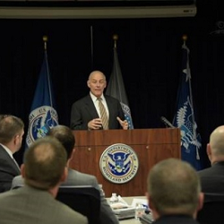 Secretary Kelly stands on podium while addressing HSI leadership at the ICE Training Academy in Dallas.