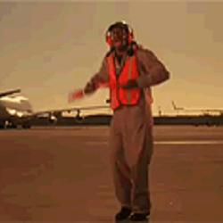 A gentleman aircraft marshalling.