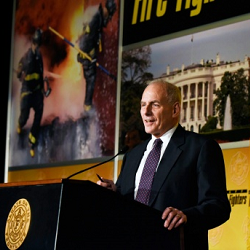 Secretary Kelly stands at podium to thank the IAFF members.