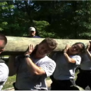 Agents lifting a log