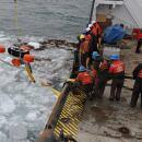 Crewmembers Remove Spilled Oil from Ice (USCG)