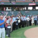 One Hundred New Citizens Sworn in Before Baseball Game