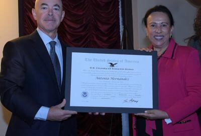 Deputy Secretary Mayorkas and Antonia Hernandez pose with a certificate