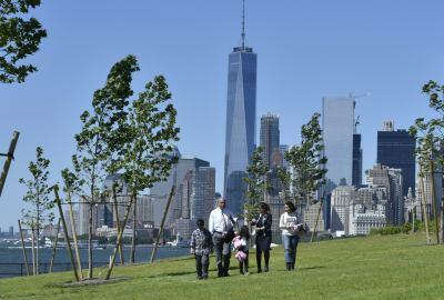 Secretary Johnson, Jaafar and his family in front of the World Trade Center