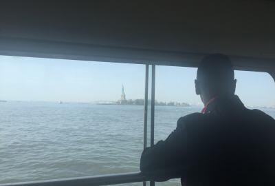 Secretary Johnson travels by boat to Ellis Island