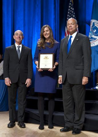 Secretary of Homeland Security Jeh Johnson and Deputy Secretary of Homeland Security Alejandro Mayorkas presented the Secretary's Customer Service Award to Transportation Security Administration's @AskTSA Team Jennifer Plozai