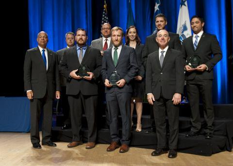 Secretary of Homeland Security Jeh Johnson and Deputy Secretary of Homeland Security Alejandro Mayorkas presented the Secretary's Unit Award to members of the U.S. Immigration and Customs Enforcement Counterintelligence Team Christopher R. Pascua, Jason A. Axley, Jessica L. Nelson, Carlos L. Romero, Errol B. Van Ommeren, Sean R. Sullivan, and Brian M. Hahn.