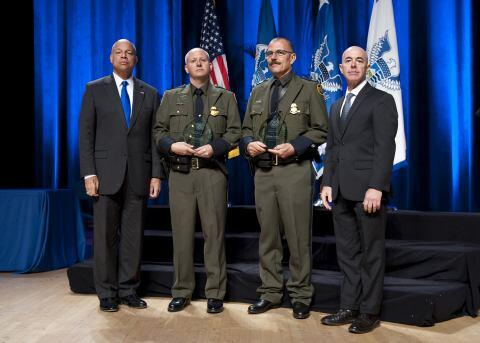 Secretary of Homeland Security Jeh Johnson and Deputy Secretary of Homeland Security Alejandro Mayorkas presented the Secretary's Award for Valor to U.S. Customs and Border Protection Zone 1 River Team Phillippe Morgue and Nathan Kimball.