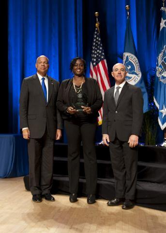 Secretary of Homeland Security Jeh Johnson and Deputy Secretary of Homeland Security Alejandro Mayorkas presented the Secretary's Award for Valor to Gloria L. Betts.
