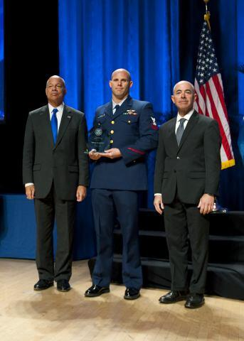 Secretary of Homeland Security Jeh Johnson and Deputy Secretary of Homeland Security Alejandro Mayorkas presented the Secretary's Award for Valor to Petty Officer 2nd Class Robert B. Granger.