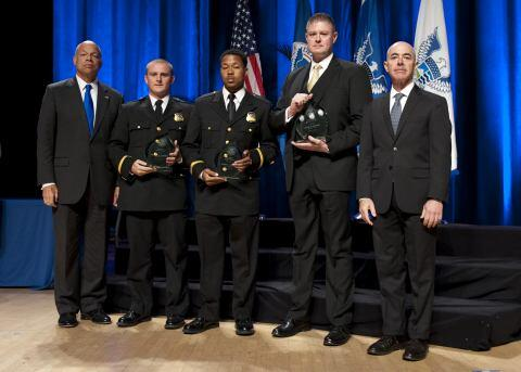 Secretary of Homeland Security Jeh Johnson and Deputy Secretary of Homeland Security Alejandro Mayorkas presented the Secretary's Award for Valor to the U.S. Secret Service agents White House Team Kevin D. Moloney, Joshua L. Johnson, and Matthew R. Williams.