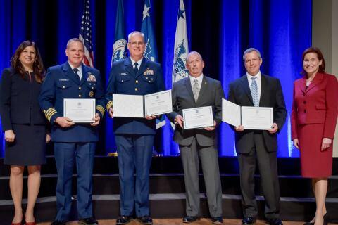 The Eastern Caribbean Regional Integrating Group receive the Secretary's Unity Effort Award at the Department of Homeland Security Secretary's Awards Ceremony in Washington, D.C., Nov. 8, 2017. The group, comprised of Immigration and Customs Enforcement and U.S. Coast Guard, was honored for working together in support of the DHS mission, to gather intelligence, investigate and interdict criminals. Official DHS photo by Jetta Disco.