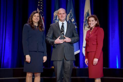 Jason O'Doherty, U.S. Coast Guard, receives the the Secretary's Award for Exemplary Service at the Department of Homeland Security Secretary's Awards Ceremony in Washington, D.C., Nov. 8, 2017. O'Doherty was honored for his initiative in managing a recycling program, which reduced hazardous waste disposal costs and preventing millions of dollars in environmental fines. Official DHS photo by Jetta Disco.