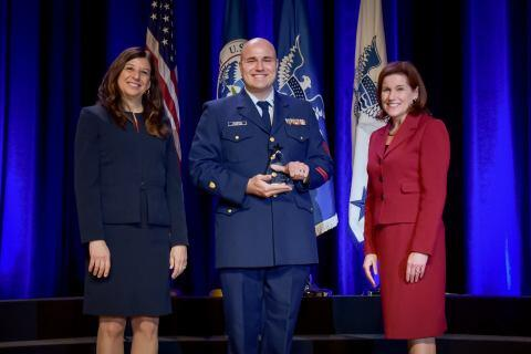 Petty Officer 1st Class Mason Camplin, a culinary specialist in the U.S. Coast Guard, receives the the Secretary's Award for Exemplary Service at the Department of Homeland Security Secretary's Awards Ceremony in Washington, D.C., Nov. 8, 2017. Camplin was honored for his outstanding culinary professionalism and proficiency in support of the Republican National Convention, and successfully hosted more than 40 official events for leaders in the top levels of government. Official DHS photo by Jetta Disco.