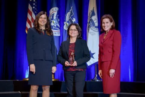 Nora Fuentes, Management Directorate's Office of the Chief Procurement Officer, receives the the Secretary's Award for Exemplary Service at the Department of Homeland Security Secretary's Awards Ceremony in Washington, D.C., Nov. 8, 2017. Fuentes was honored for her exemplary work processing the Department's contract files. Official DHS photo by Jetta Disco.