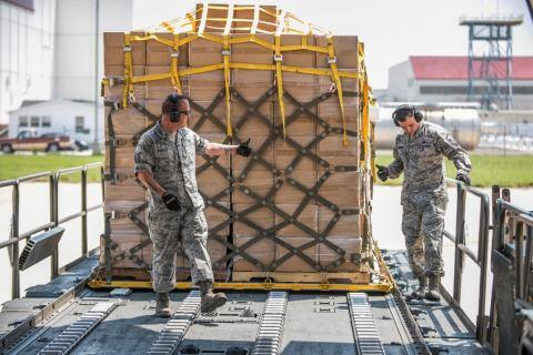 Canada Department of National Defense move cargo scheduled to be delivered to hurricane survivors.