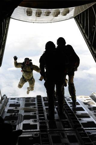 Rescuemen Jump Out of Plane (USCG)
