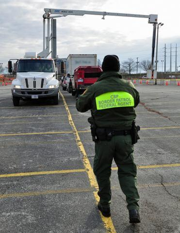 CBP Agent Conducts Cargo Inspection at Superbowl XLVI