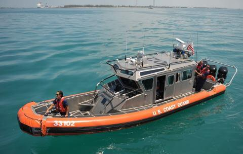 Boat Crew Retrieves Part from CGC Eagle (USCG)