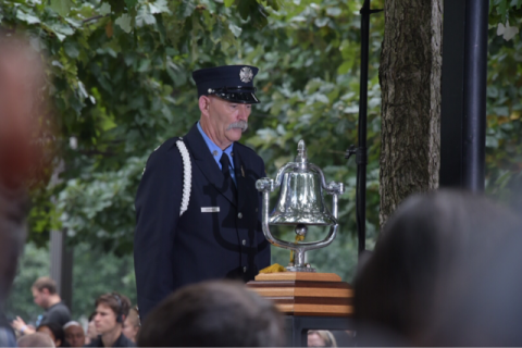 Firefighter rings ceremonial bell to mark moments of silence at National September 11 Memorial