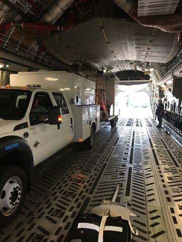 DOBBINS AIR FORCE BASE, GA 9/24/2017 - A Mobile Emergency Response Support Tactical Radio Vehicle and Land Mobile Radio Tower is loaded into a C-17 Globemaster. The Disaster Emergency Management Division sent a four-man team from Frederick, Maryland, to provide emergency communications for search and rescue efforts and incident management teams deployed to Puerto Rico in the aftermath of Hurricane Maria. (Photo by Bob Speakman)