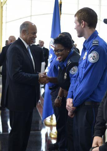 secretary johnson shares a laugh with a transportation security officer - Transportation Security Officer