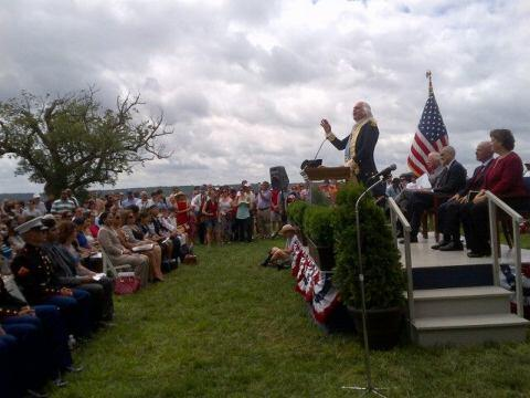 An Actor Portraying George Washington Addressing the Crowd