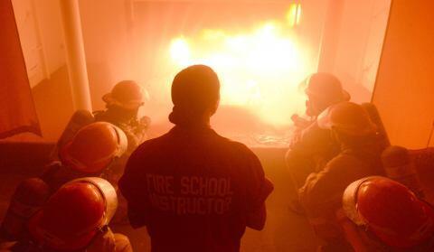 Recruits managing a simulated fire.