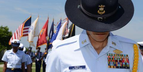 Battalion commander bows his head.