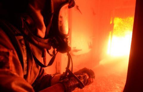 USCG recruit in a fire simulator