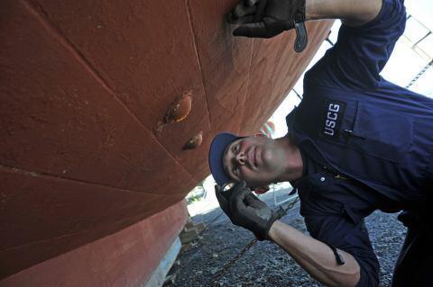 Guardsman visually inspecting water intakes.
