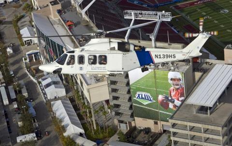 A CBP helicopter patrols over Superbowl XLIII