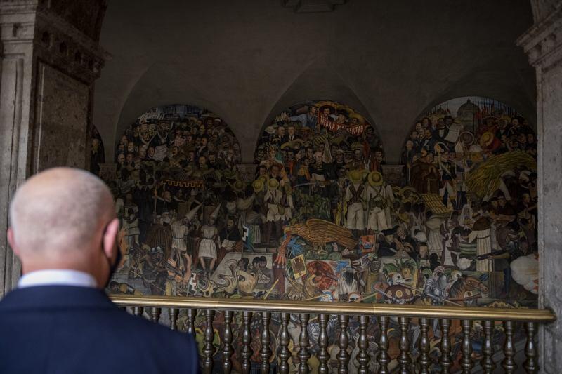 Secretary Mayorkas looks at Diego Rivera's mural at Mexico's Palacio Nacional