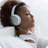 Woman wearing headphones, relaxing