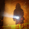 A first responder searching in a fire.