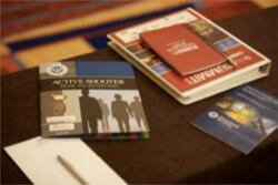 Training materials and pamphlets on a table.