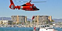 U.S. Coast Guard helicopter flying over city