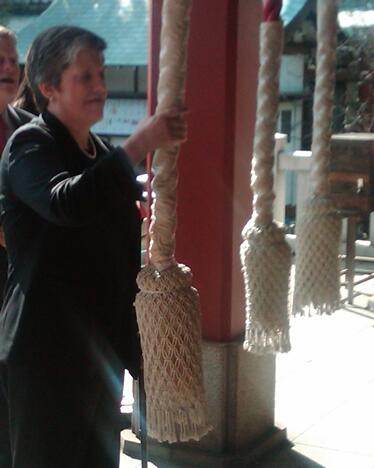 Secretary Napolitano rings a bell at the Hai Shrine in Tokyo.