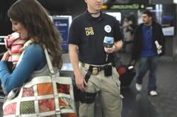 Officer conducting security at an airport.