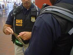 Two DHS officers in discussion