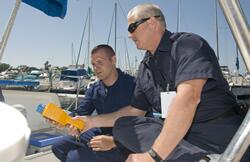 Two officers checking nuclear security on a boat.
