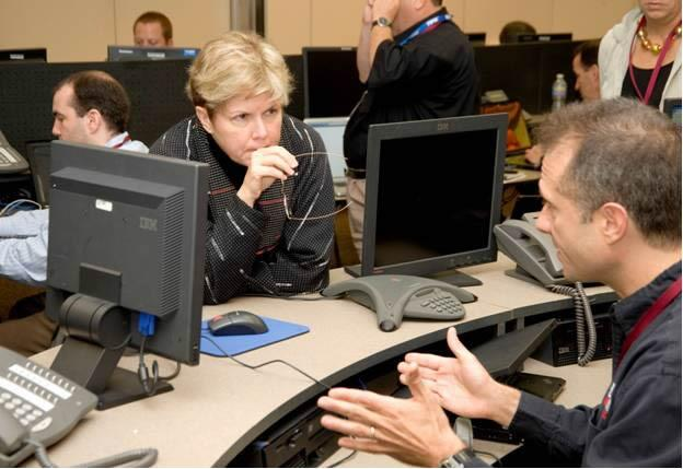 A Cyber Storm III exercise participant briefs Deputy Secretary Jane Holl Lute during the exercise kickoff at U.S. Secret Service headquarters in Washington, D.C.