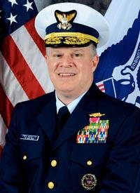 Military Advisor Rear Admiral Fred M. Midgette