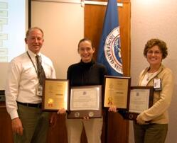 Adam Hutter, Director of NUSTL, presents Cecilia Murtagh (center) and Gladys Klemic with plaques commemorating DHS's first patent.  Not pictured: co-investigator Paul Bailey, now at the University of Maryland. (Jenny May)