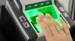 Person having fingers scanned on the fingerprint scanner